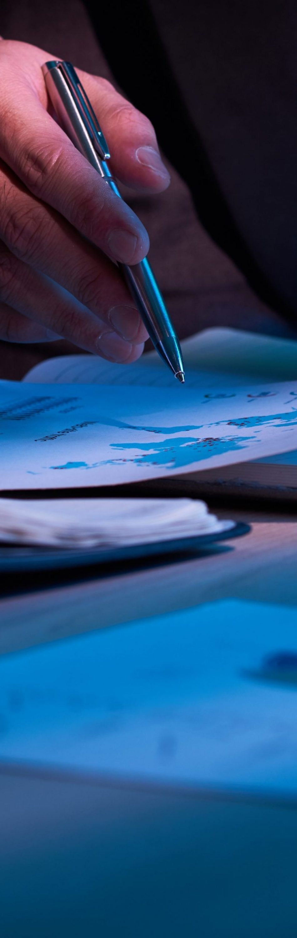 Close-up image of business partners working with financial documents
